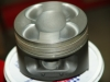 Projects - Porcshe 928 - close view of modified early 32 valve pistons with enlarged cutouts for valves